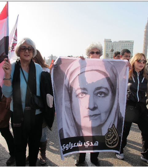 Egyptian Women Hold a Picture of Huda Shaarawi. Women Played a Key Role in Bringing Down Mubarak's Government. Image Credit: Flickr