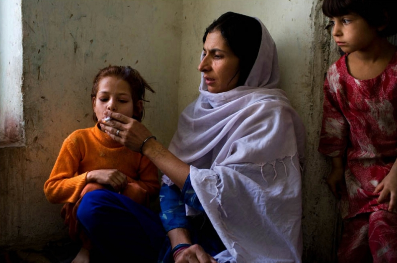 Mother & Child: Secluded From Society, Afghan Women Use Hashish To Spend Long Hours at the Loom, and Frequently Feed the Drug to Their Children, too. Image Credit: Flickr