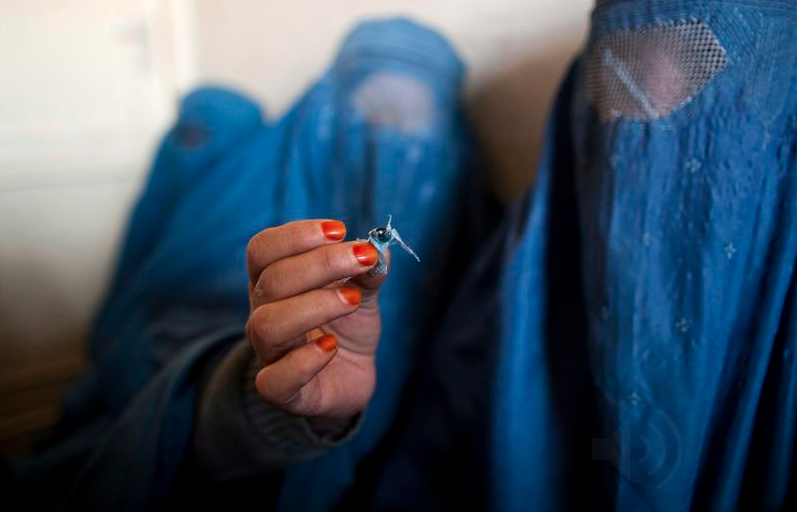 Drug of Choice: An Afghan Woman at a Rehab Center in Kabul Holds Up Opium. Image Credit: Free Speech