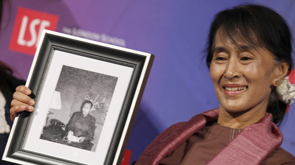 Myanmar pro-democracy leader Aung San Suu Kyi holds a photograph of her father, which was presented to her following a discussion at the London School of Economics. Image Credit: Flickr