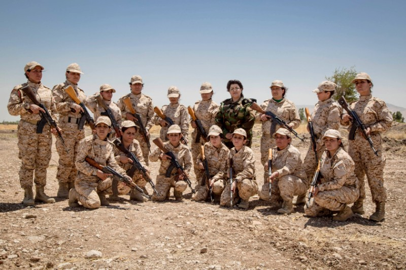 The women Peshmerga of the 2nd Battalion pose for a group portrait after a military exercise. Image Credit: Flickr.