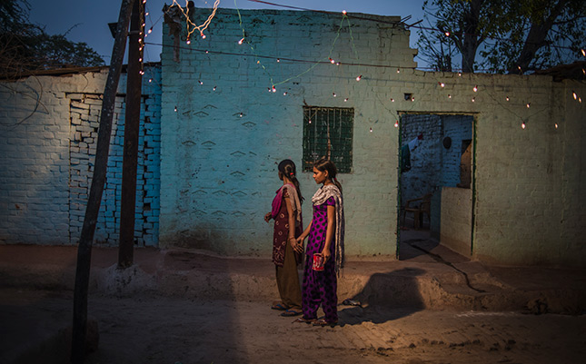 Women and girls often travel in pairs in the dark to relieve themselves in open fields. Image Credit: WaterAid.