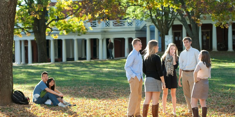 "UVa students enjoy a fall afternoon on the ""Lawn"", on the ground"